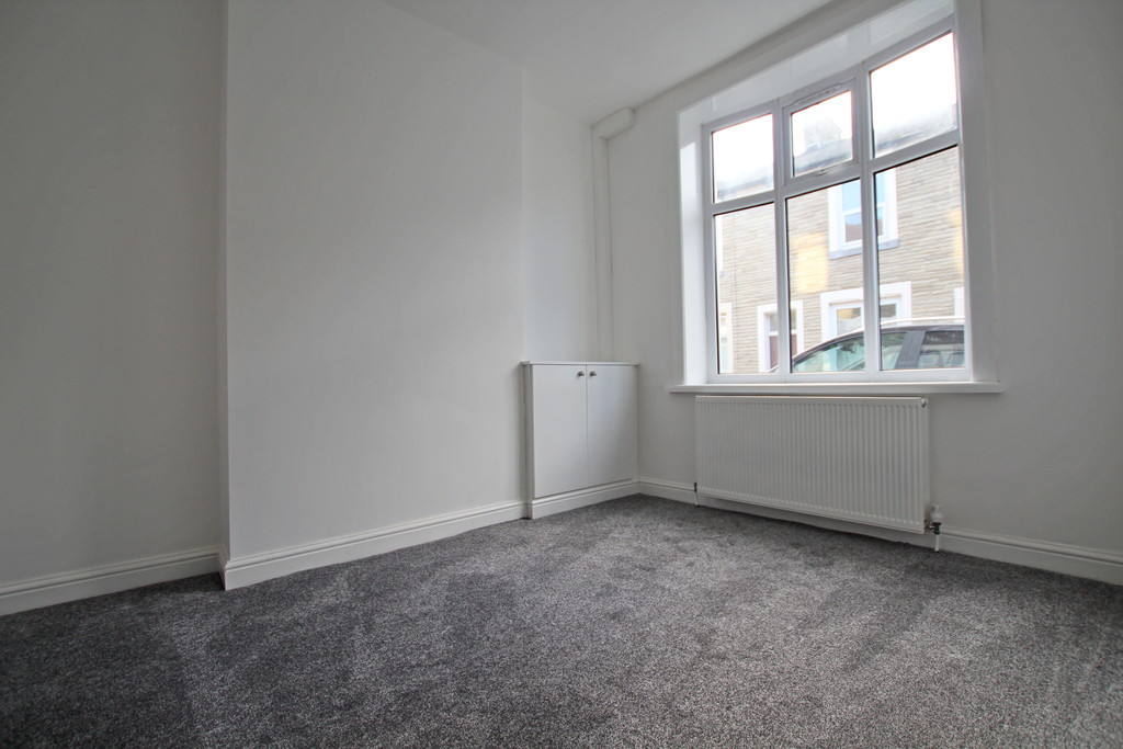 3 bedroom mid terraced house To Let in Burnley - photograph 2.