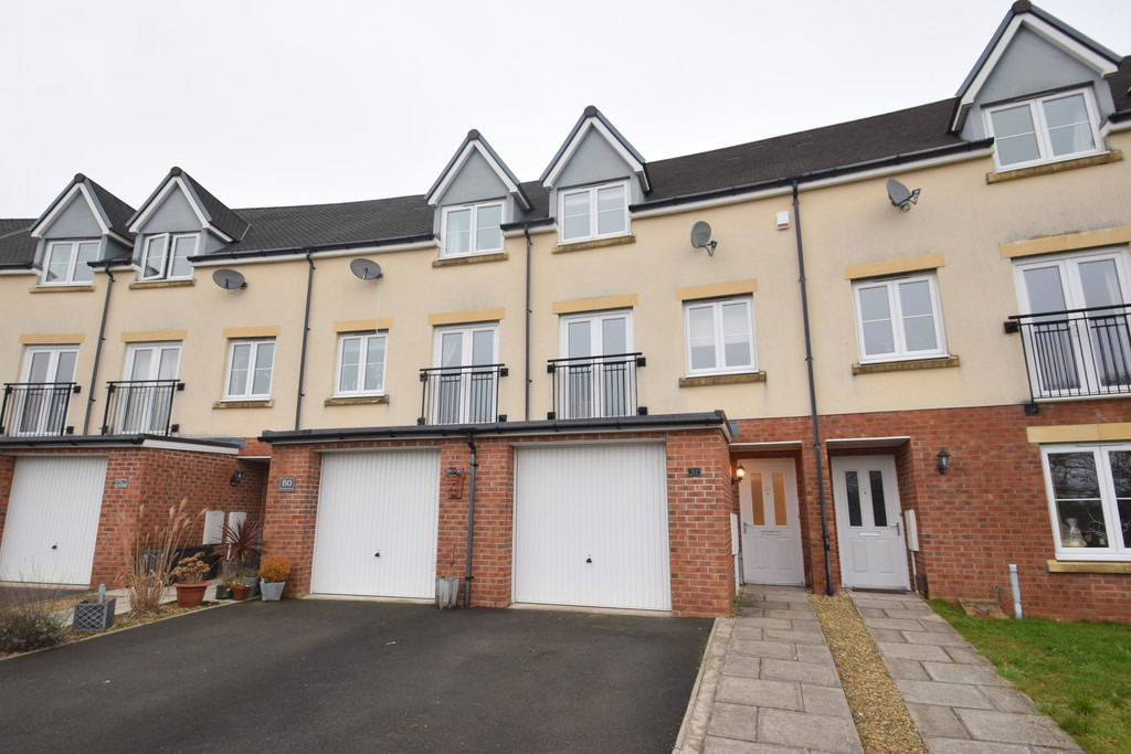 An Immaculately Presented Four-Bedroom Mid-Terraced Townhouse Located In The Popular Wood Green Development In Bridgend